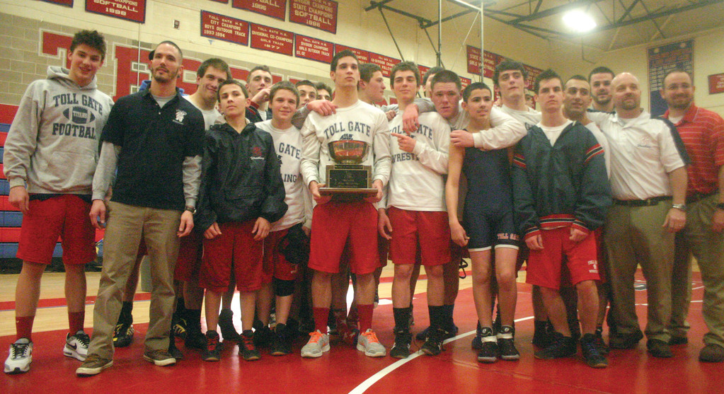 TITANS ON TOP: The Toll Gate wrestling team shows off the cup after winning the City Championship on Thursday. The program had never won in the 11-year history of the City Championship.