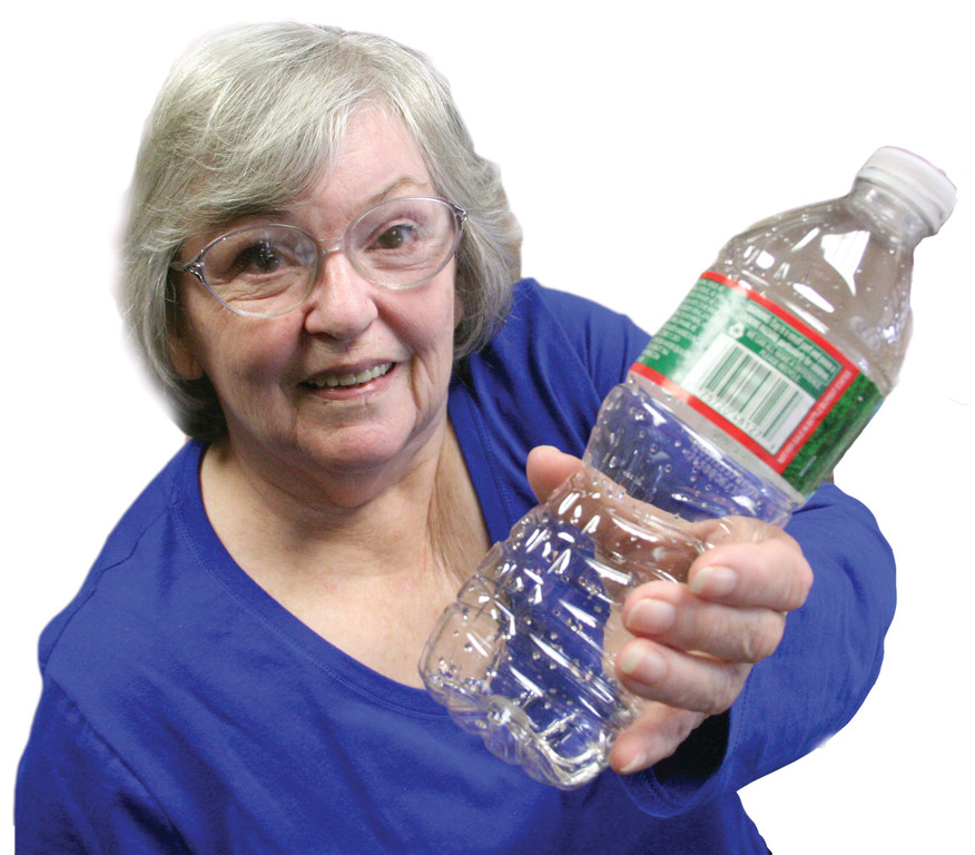EMPTY BOTTLE: Diane Higgins holds up an empty water bottle. Higgins regularly buys the water at the Pilgrim Senior Center. It sells for 55 cents.