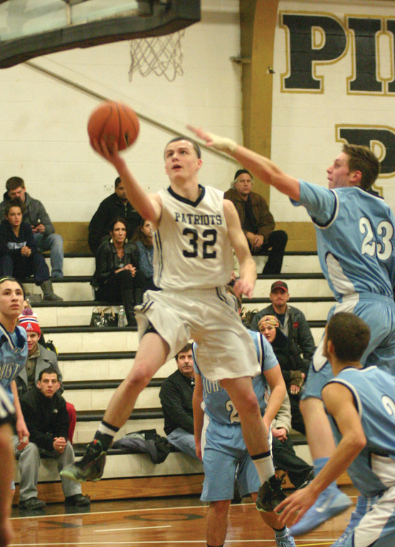 UP STRONG: Chris Duchesneau flies to the hoop in Tuesday's win over Johnston. The Pats improved to 4-3.