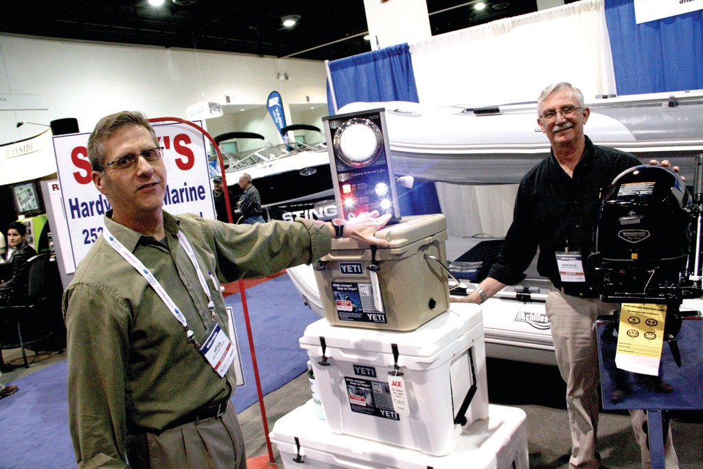 SMALL IS BETTER: Jeff Salk and Kevin DeWolfe manned the Salk's Hardware and Marine show booth. They said interest was especially keen in smaller inflatable boats.