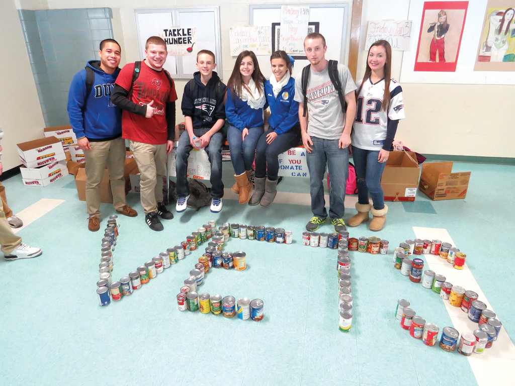 SPIRITED SOUPER BOWL: Students in the Leadership Academy at Vets High School show off their school pride during Friday�s �Souper� Bowl food drive for Buttonwoods Community Food Bank.