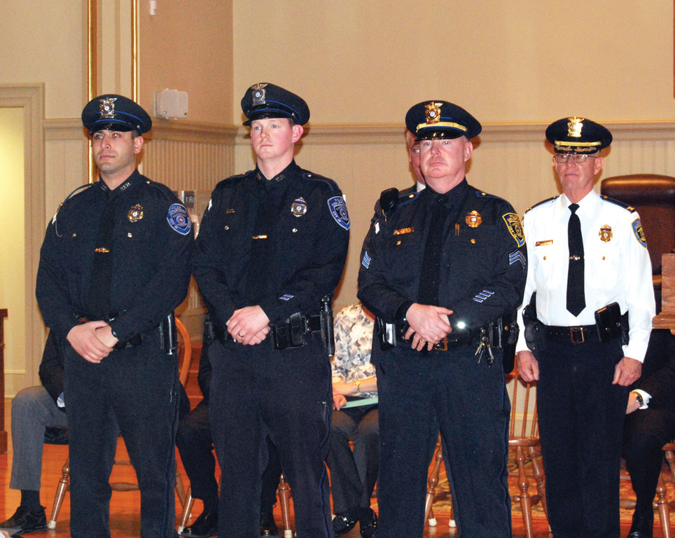 HONORED SERVICE: Officer Hovsep A. Sarkisian, Officer Joshua P. Myer and Sergeant John V. Kelly Jr. were among the police officers to receive commendations from Col. Stephen McCartney during last week's Warwick Police Department Promotion Ceremony.
