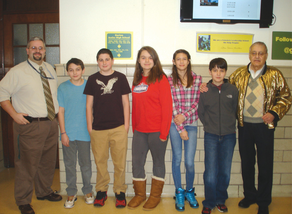 KEEP UP THE GOOD DEEDS: Principal Jeff Taylor and students Cole Baker, Thomas DiPetrillo, Autumn Provonsil, Lexie Higgins and Justin Provonsil welcomed Alan Shawn Feinstein to Gorton Junior High School during a recent visit. Feinstein visits the school to encourage students to continue performing good deeds as they did as elementary students.