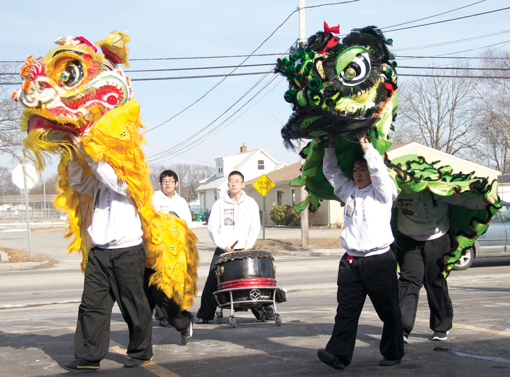 drummer Tony Hu, Liz Nhep and Tiffany Lam keep the beat during the Lion Dance at Han Palace on Saturday.