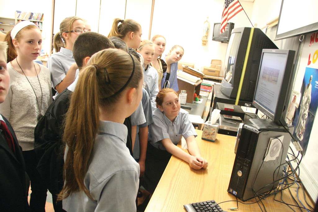 ONLINE: Keeley Kirejczyk displays her website project: The Boston Tea Party – Rights & Responsibilities – to fellow St. Rose of Lima classmates.