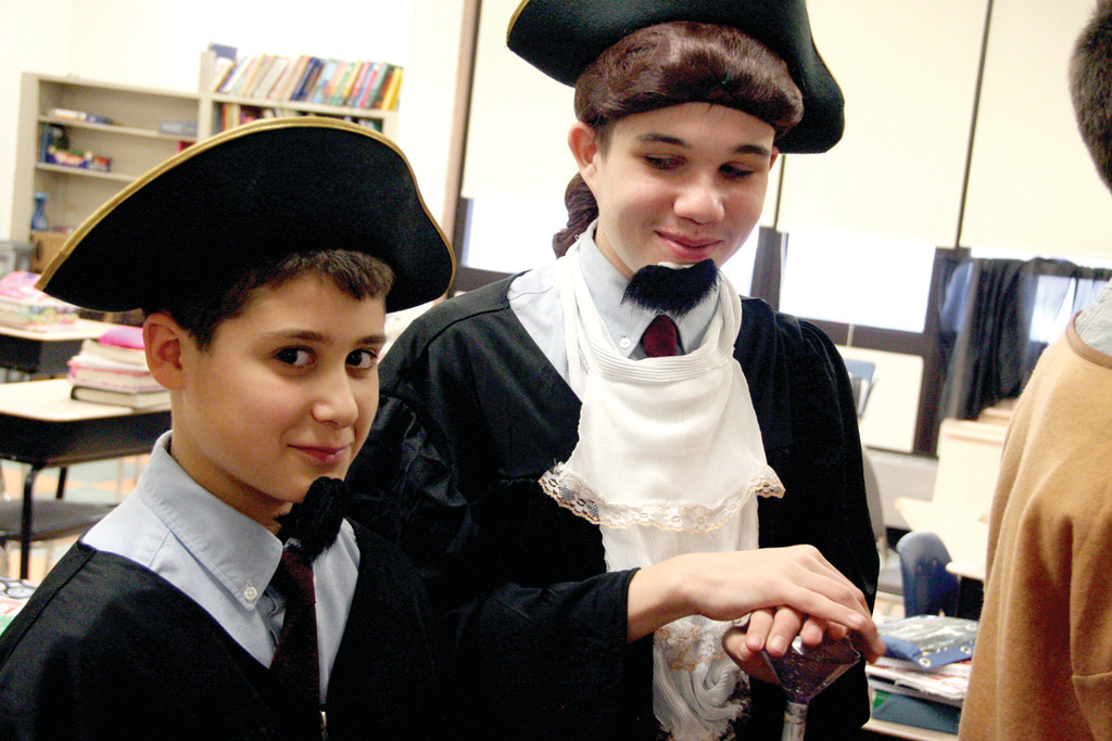 FAMILIAR PAIR TO RHODE ISLANDERS: Derek Razza, assuming the charter of Roger Williams, and Chandler Harkins, as Samuel Gorton, selected the skit portion of the history day projects.