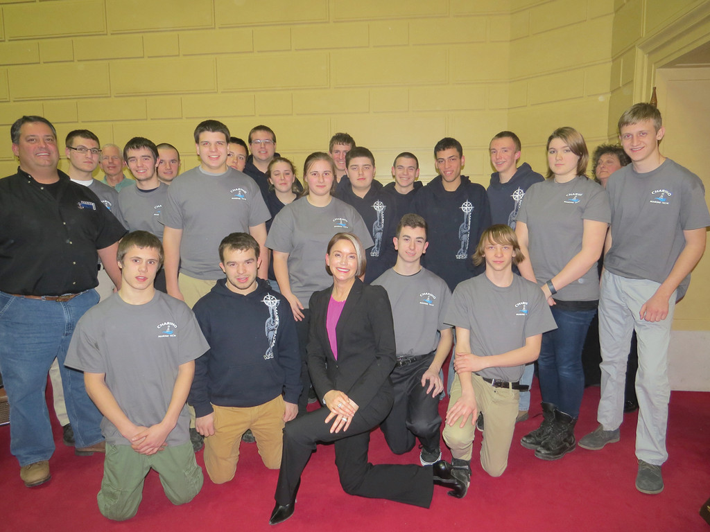 SHIP-BUILDING SUPERSTARS: Education Commissioner Deborah Gist took time to meet with the students and teachers from Warwick Career and Technical Center�s Marine Trades program (in black sweatshirts) and Chariho Career and Technical Center (in blue shirts), who would be live-building a canoe during the Providence Boat Show this past weekend.