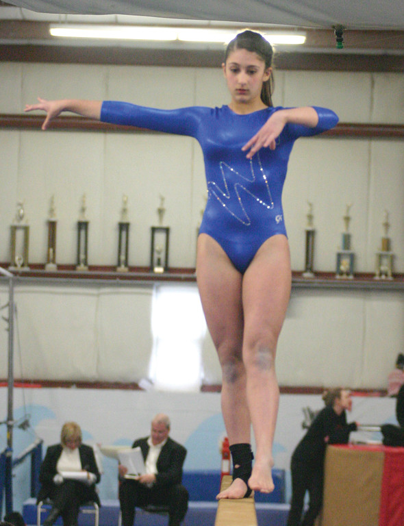 Vets' Dayna Razza competes on the beam earlier this season.