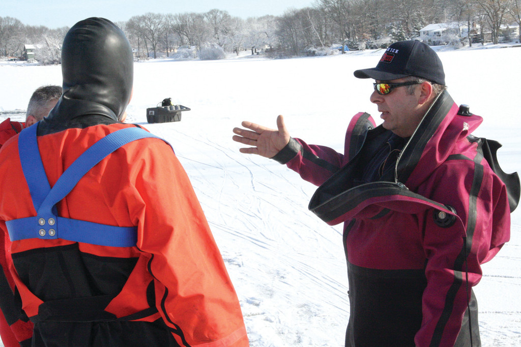 DIRECTING TEAM: Rescue Lt. Gary Pelliccio directed Tuesday's ice diving drill on Sandy Pond behind Vets High.
