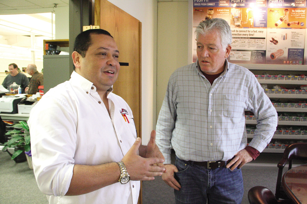 NEXT STEP: Libardo Ochoa and John Cronin discuss plans for expansion at Quick Fitting.