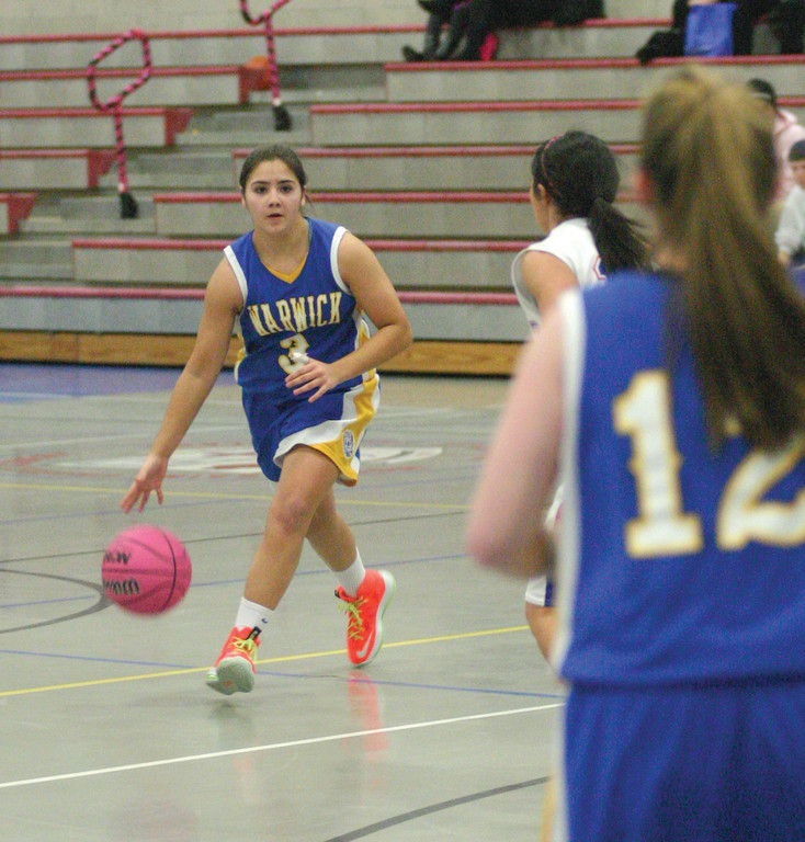TOP OF THE KEY: Vets' Kat Raposo looks for an open teammate during Tuesday's game at Mount St. Charles. The 'Canes snapped a two-game skid with a 20-point win.