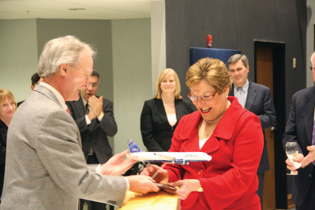 GET AWAY FLIGHT: Governor Chafee presents Dr. Kathleen Hittner with a model of a jetBlue Airbus during a reception in her honor Thursday night. Hittner, recently named the state Health Insurance Commissioner, is stepping down as chair of the Rhode Island Airport Corporation.
