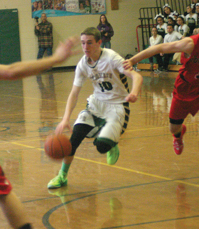 TO THE RACK: Hendricken's Kyle Henseler drives to the basket during Sunday's win over Coventry.