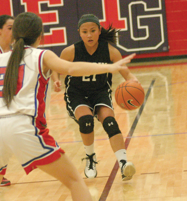 LOOKING FOR ROOM: Pilgrim's Clare Birney brings the ball up the court in Thursday's game against Toll Gate.