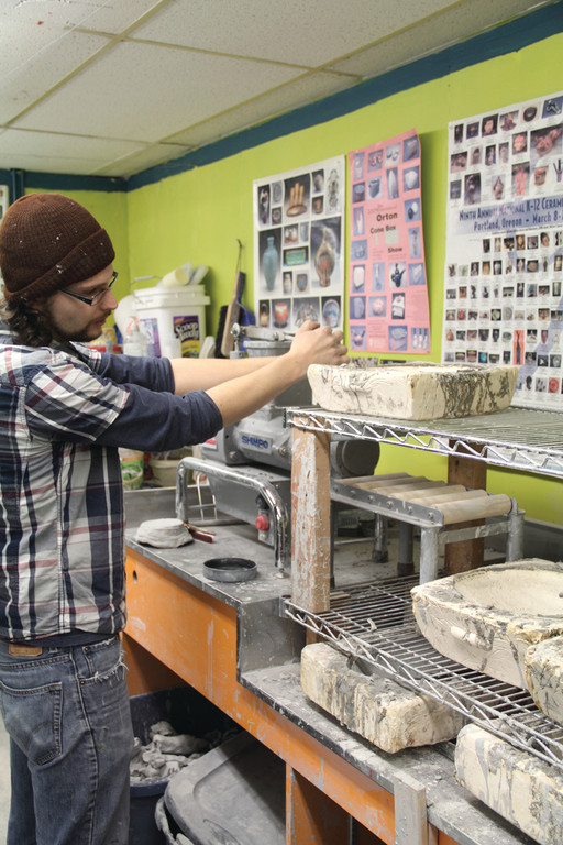 CRAFTING SOMETHING SPECIAL: Instructor Brian Medeiros works on ceramics at the Artists' Exchange.