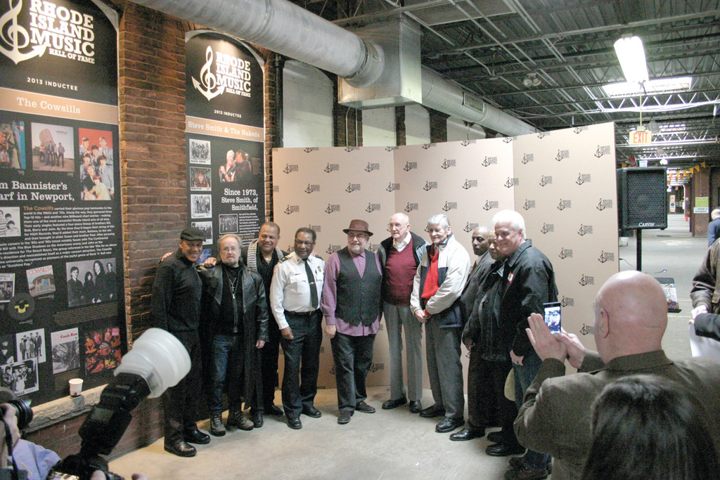 "GOOD COMPANY: The members of the Rhode Island Music Hall of Fame's class of 2014 gather during a Feb. 7 event at the Hope Artiste Village complex in Pawtucket. Among them are Winston ""Wayne Powers"" Cogswell, third from right, and Ray Peterson, fourth from right, who are being inducted jointly as The Mark II."