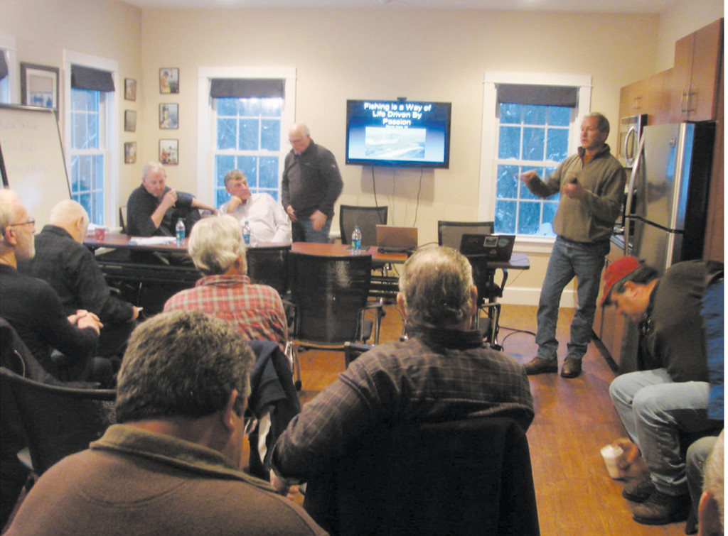 Fishing with windmills: Capt. Rick Bellavance (left) at the Commercial Fisheries Center in South Kingstown facilitates a discussion last week with three fishermen that have learned to live and fish with windmills off Ramsgate, England.