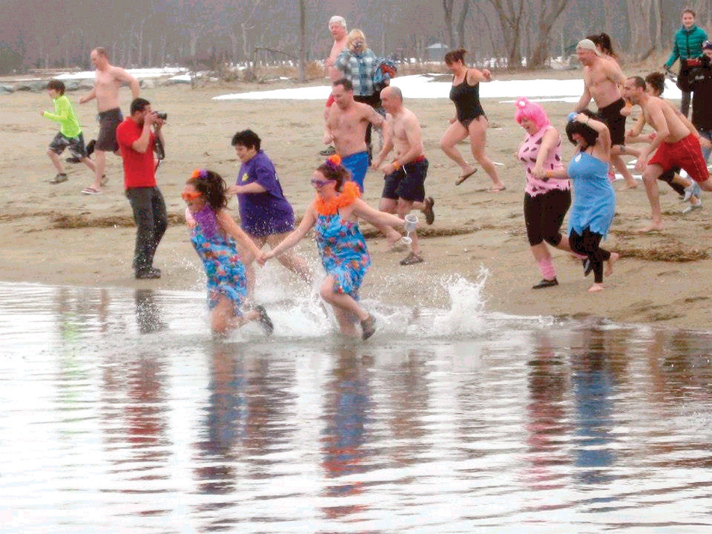 FREEZIN' FOR A REASON: The 2nd Annual Polar Dip is scheduled for Saturday at noon on Oakland Beach, with registration starting at 10 a.m. Last year's event attracted 90 plungers and raised $20,000 to send 10 families to Camp Sunshine in Maine. Christina Henriques, a member of the family organizing the event and who is pictured above in the tropical outfit with her sister Rebecca, predicts this year's event will be even bigger.