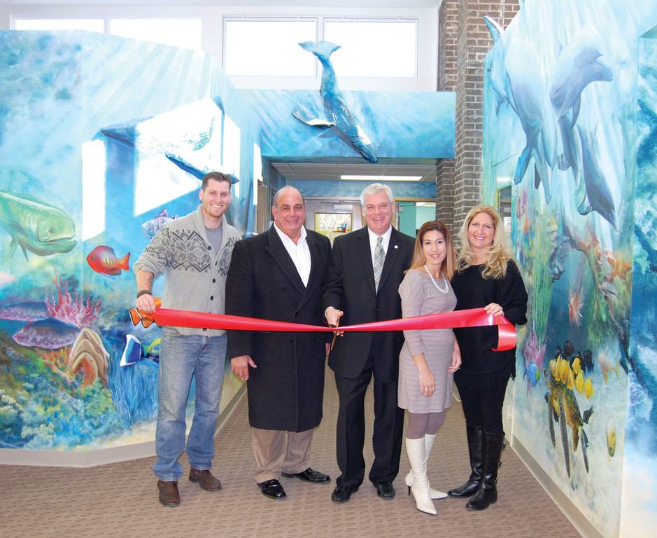 DESIGNER PRESCHOOL: Artist Paul Leighton, Councilman Joe Solomon, Mayor Scott Avedisian, and The Lighthouse Preschool owners and sisters Allison Costabile and Kristin Duffy celebrated the grand opening of the school on Jan. 30 with a ribbon cutting in the school�s lobby, surrounded by Leighton�s ocean-themed mural.