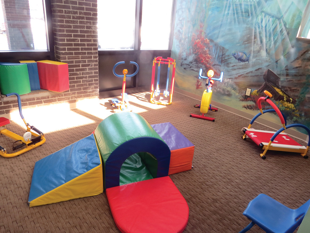 LEARN AND PLAY: While each age group has their own classroom with a kitchen and bathroom, children at The Lighthouse Preschool also have access to this adorable gym area, complete with child versions of a treadmill, elliptical, stationary bike and more.