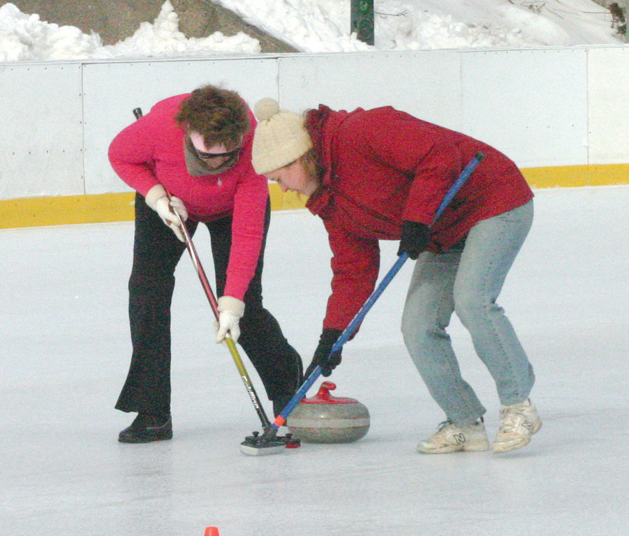 HOME CURL: Members of the Ocean State Curling Club show off their skills at a demonstration on Sunday in Providence.