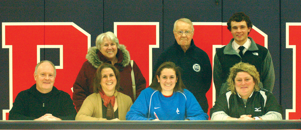 GATHER ROUND: With family and coach Lonna Razza by her side, Laura McGuire committed to Assumption.