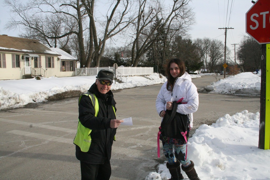 SPECIAL BIRTHDAY: Wyman Elementary School surprised their crossing guard William Thomas (pictured above with Wyman student Mariah) with a party for his 90th birthday.