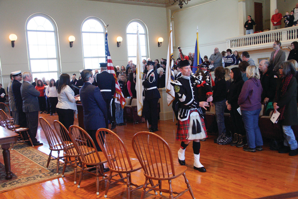 POSTING THE COLORS: With bagpiper Scott Perkins in the lead, the Warwick Fire Department color guard posts the colors.