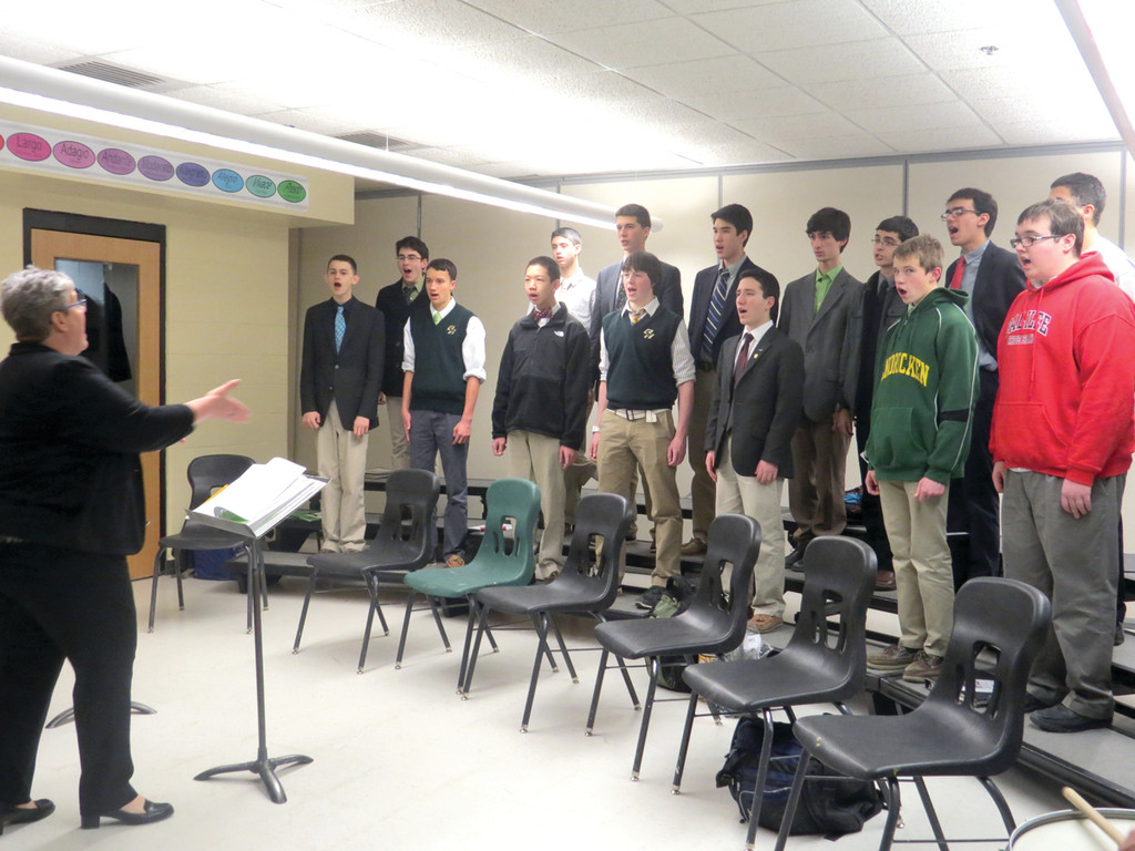 SOUNDING GOOD: Members of Hendricken's chorus put some final touches on their performance songs, under the direction of Mary Jo Gambardella, the program's vocal director.