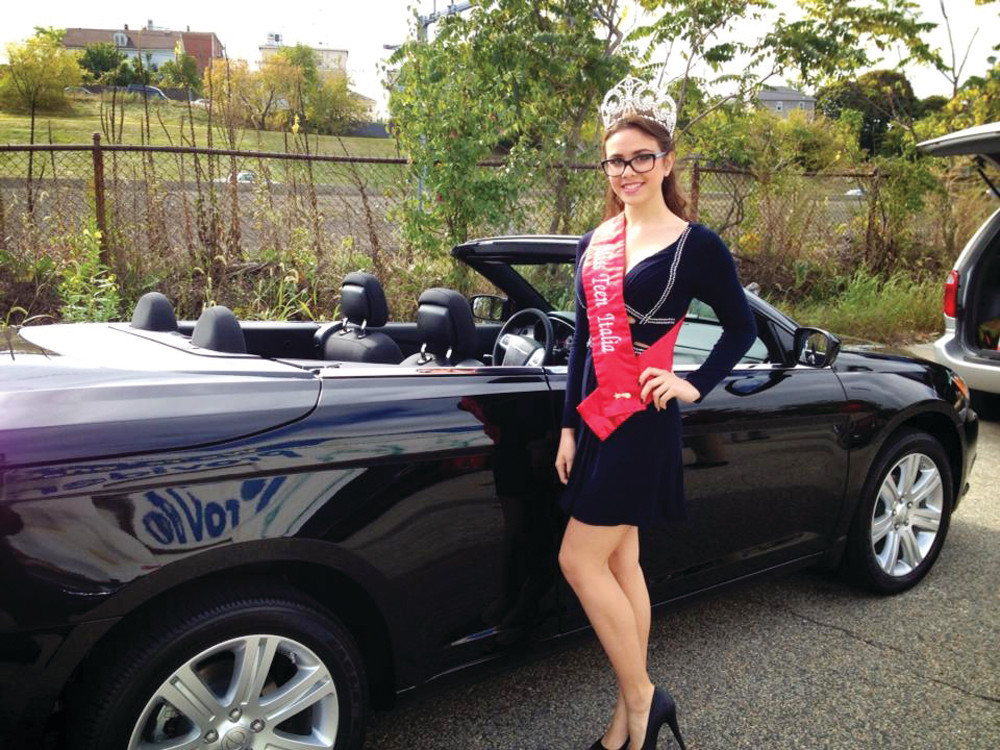 REIGNING MISS ITALIA: Malia Paolino Cruz of Warwick is the current reigning Miss Teen Italia. She is pictured here riding in the Columbus Day Parade, an annual October tradition on Federal Hill. She has enjoyed many appearances as Miss Teen Italia, which has included photo opportunities and a platform to help others.