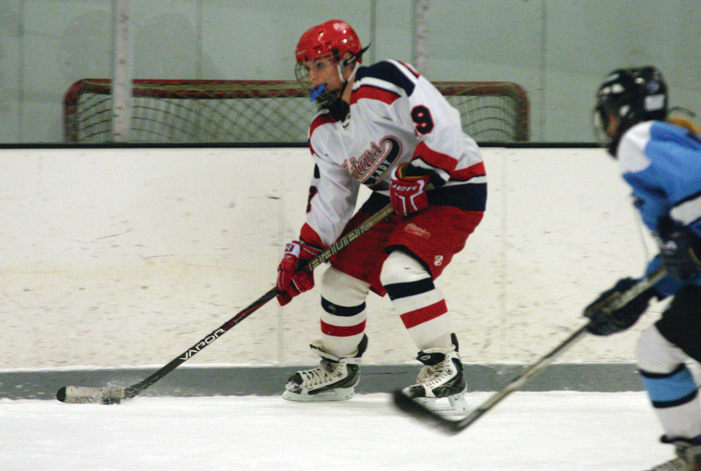 ON THE PUCK: Warwick's Alyssa Mathews skates along the boards in Friday's game.