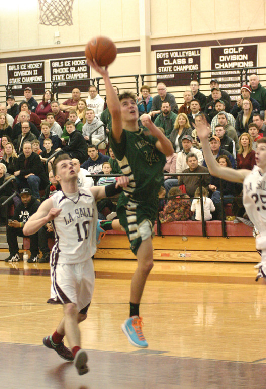 LEANING: Hendricken's E.J. Nygren takes the ball to the basket during Sunday's 76-66 loss to La Salle.