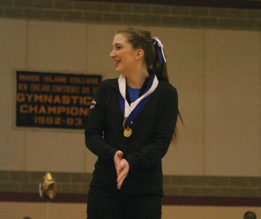 Ashley Clift is all smiles after taking third place in the floor event.