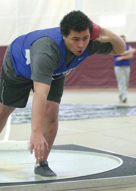 Vets Frank Merlino gets set to throw the shot put.
