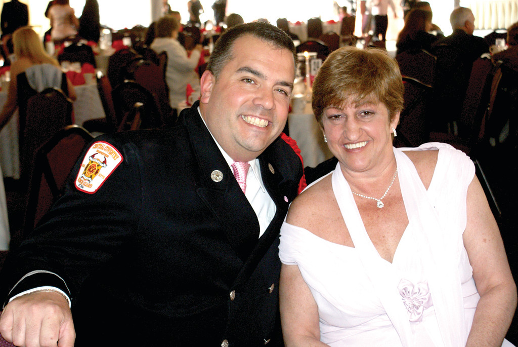 HAVING A BALL: Pictured is Lt. Ted Dion, founder of the RI Pink Heals and a member of the Central Coventry Fire District, with Meri Kennedy, a Cranston Herald, Johnston Sun Rise and Warwick Beacon reporter who is also a breast cancer survivor, at last year's Pink Heals Ball. The Pink Heals is made up of volunteers who support women battling cancer and their families.