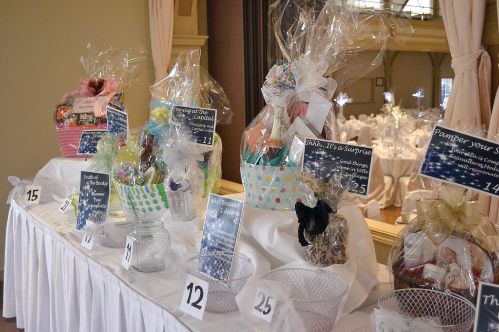 PRIZES GALORE: In addition to hearing about the student accomplishments and seeing fabulous clothes, one of the highlights of a Hendricken Fashion Show is the array of raffle baskets up for grabs, nearly 40 different prizes each year; some valued up to $1,000.