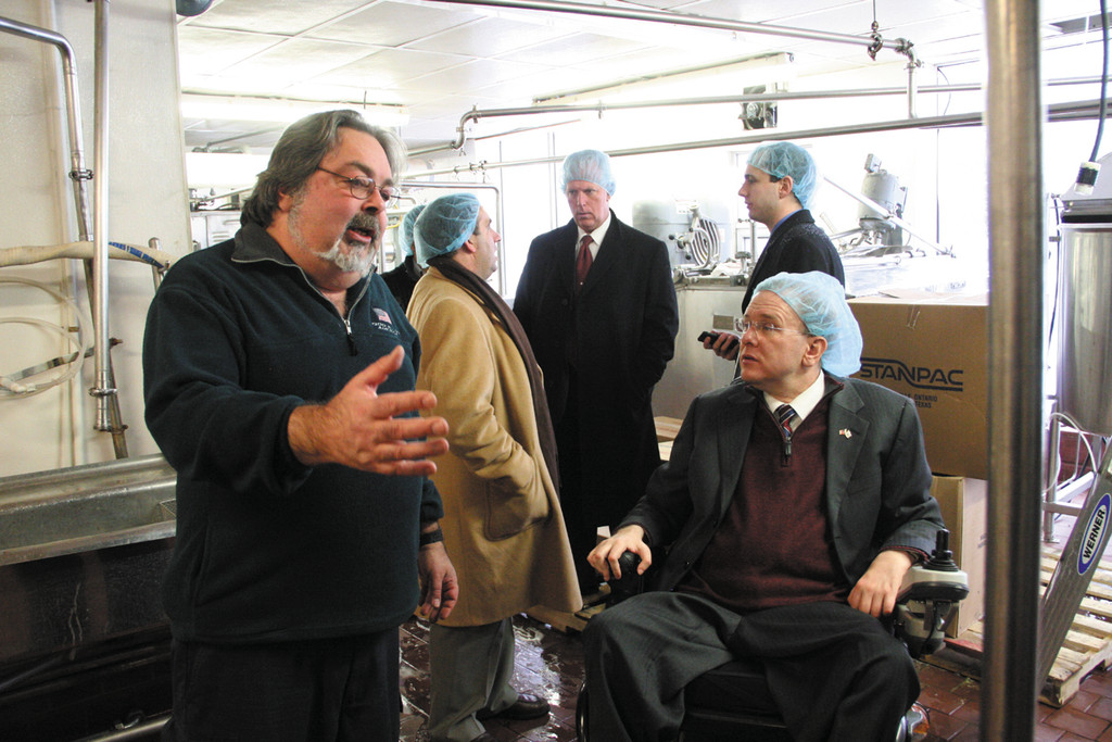 LEARNING THE ROPES: Jerry Bucci, president  of Warwick Ice Cream, the only manufacturer of ice cream in the state, gives Congressman Langevin a tour of the plant located on Route 2 in Warwick on Tuesday. Visitors were required to wear hair nets.