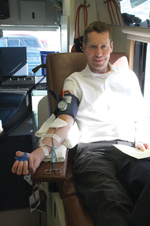DONATING: Mark McHugh keeps a tight fist while donating blood Thursday.
