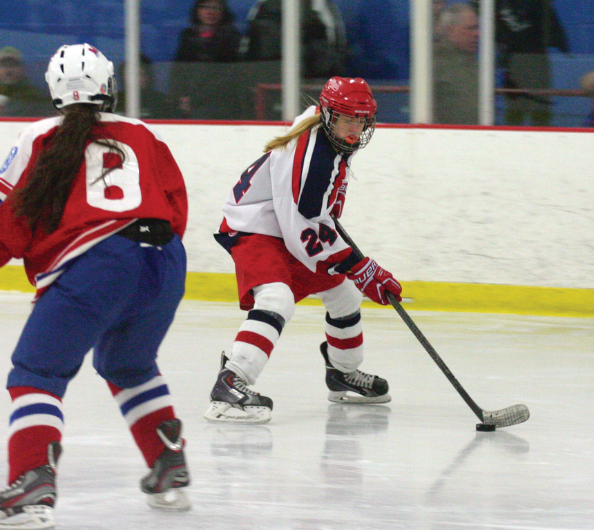ON THE PUCK: Kelsey Holmes streaks down the wing in Saturday's game with Mount.