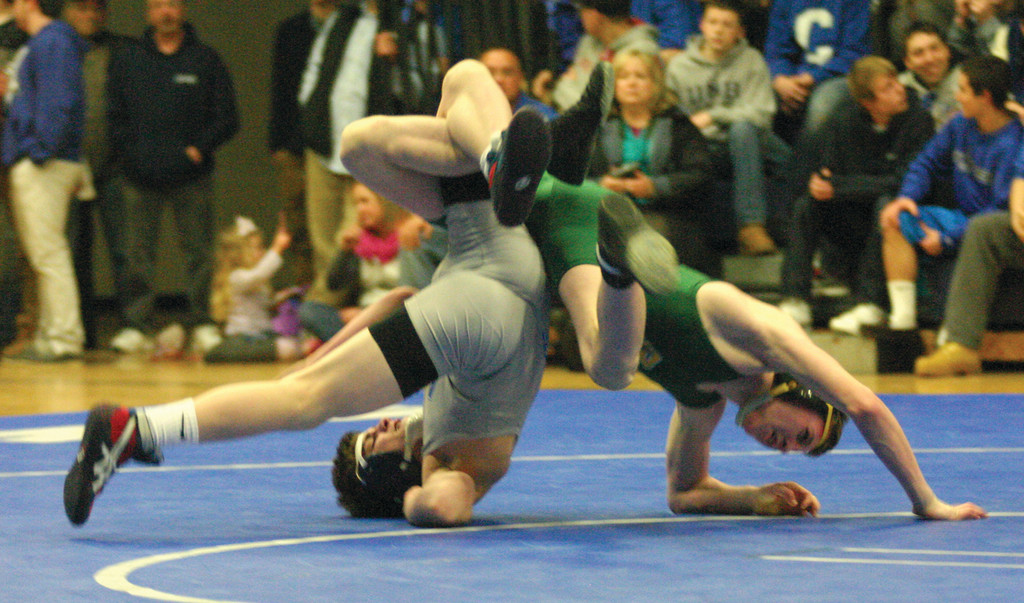 FLIP FLOP: Hendricken's Jamie Swanson wrestles Cumberland's Noah Tougas in the 126-pound weight class on Thursday night.