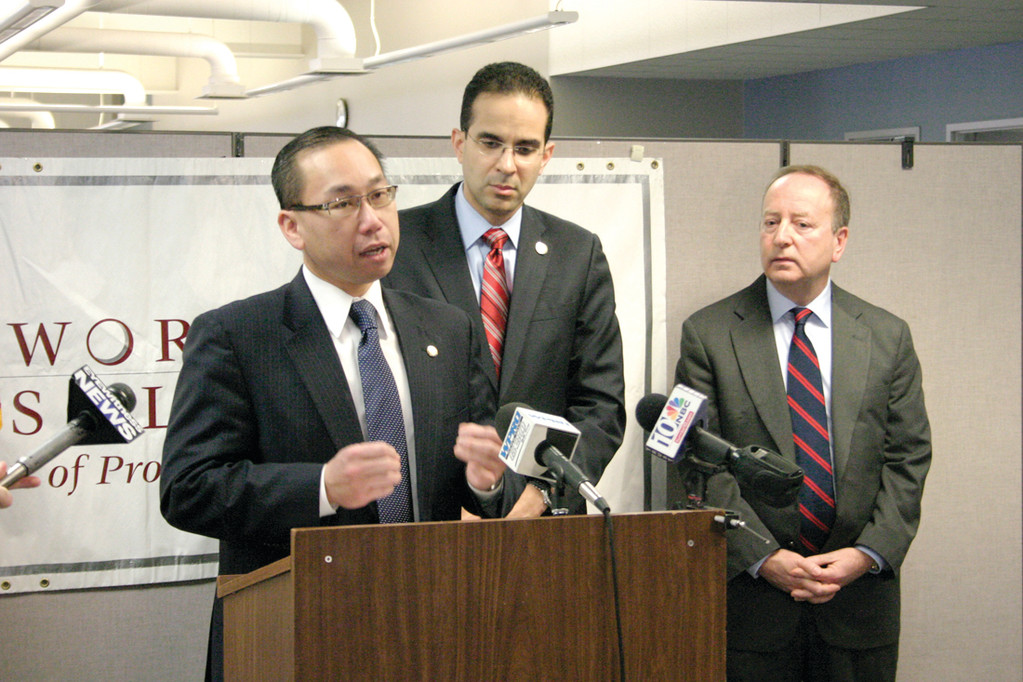 FOCUS ON JOBS: Cranston Mayor Allan Fung speaks as Providence Mayor Angel Taveras and Robert Ricci, administrator at Workforce Solutions of Providence and Cranston, look on during the recent announcement of the 2014 Mayors' Job Fairs.