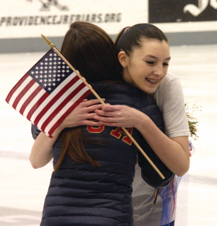 SKATING STARS: A young figure skater shares a hug with Marissa Castelli. Skaters from several local clubs who take lessons from Marissa and her mother, Lori, put on a show at Monday's celebration.