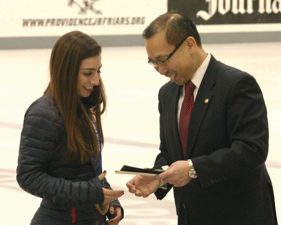 CRANSTON PROUD: Mayor Allan Fung presents Marissa Castelli with a key to the city at Monday�s celebration.