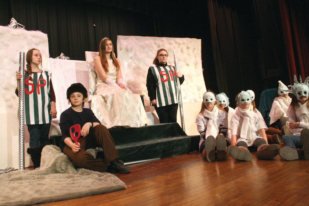 THE PALACE: The queen played by Julie Davis; her guards, Kiley McAleer and Liz Pauley and the goblin, Brett Bernier take their positions.