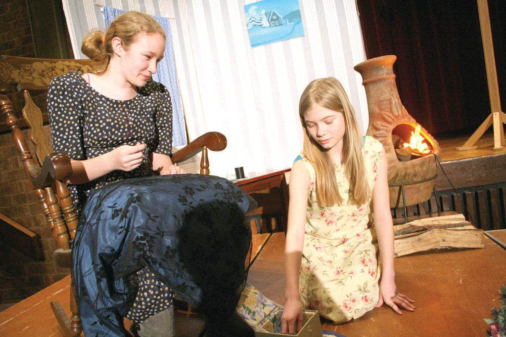 BY THE STOVE: Lauren Campbell, who plays the grandmother and Cathryn Dewolf, who plays Gerda in a scene from the play.