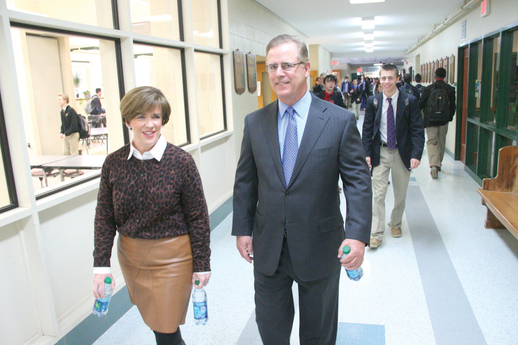 IN THE HENDRICKEN HALLS: Jon Roberts, executive vice president of CVS Caremark Corporation, makes his way to the school's theater with Martha Murray, special events coordinator, where he spoke about business careers last Wednesday.