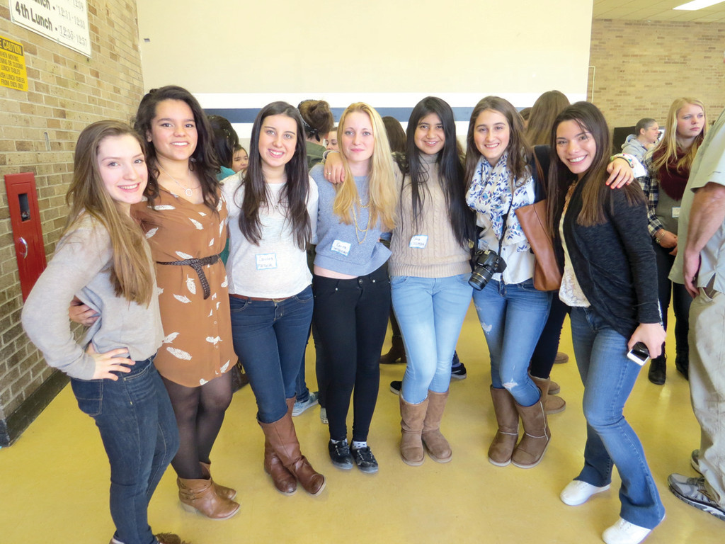 GIRL TALK: Pilgrim junior Aislinn Curry, Pilgrim senior Brianna Tuscani, Carolina Nunez of Portugal, Corina Schoenberger of Switzerland, Ana Carrillo of Colombia, Paula Valverde of Spain and Pilgrim junior Hailey Puco chatted, laughed and snapped pictures like any group of teenage girls at the AFS Club Exchange Student Meet and Greet at Pilgrim High School during the exchange students' long weekend visit to Rhode Island.