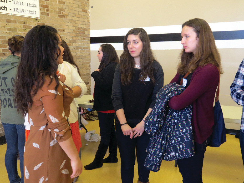 QUESTION AND ANSWER: Pilgrim senior Brianna Tuscani (pictured above talking with two visiting exchange students) said the best part of being a part of ASF Club is getting to meet teenagers from around the world, building relationships and learning about culture from those that live it.