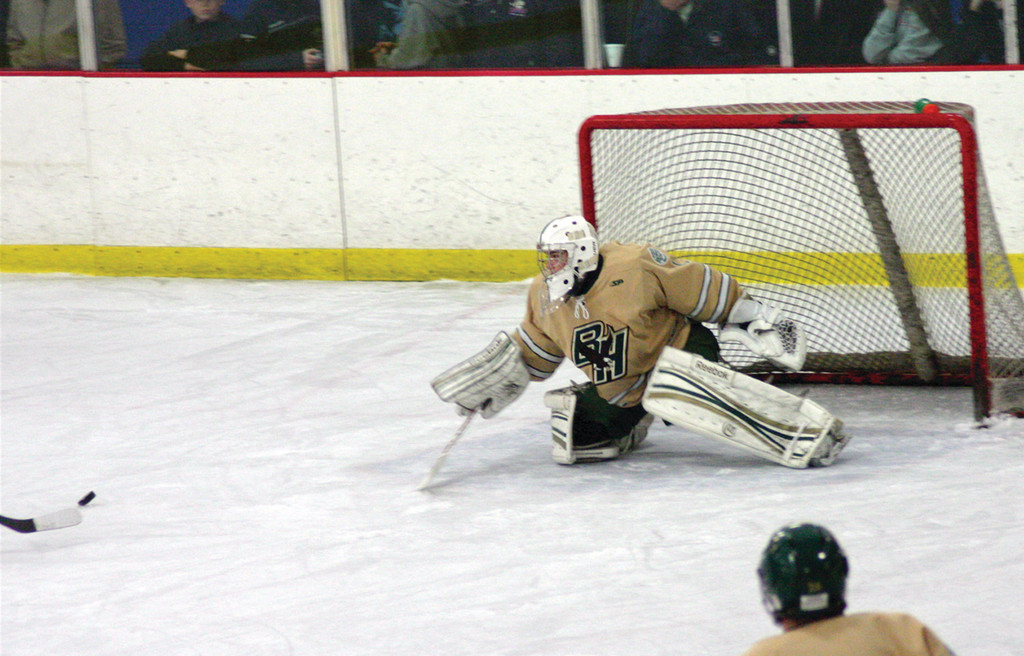 FLYING AROUND: Hendricken goaltender Matt Kenneally gets back in position after making a save during Saturday�s 1-0 victory over Mount St. Charles.