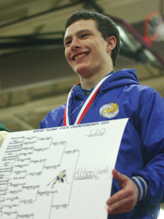 FOUR: Vets senior John Altieri takes the medal stand after his win.